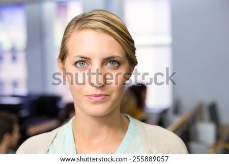 Close up portrait of confident female teacher smiling - stock photo