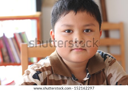 close up portrait of cute asian boy smiling - stock photo