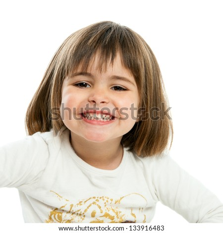 Close up portrait of cute girl showing teeth. Isolated on white. - stock photo
