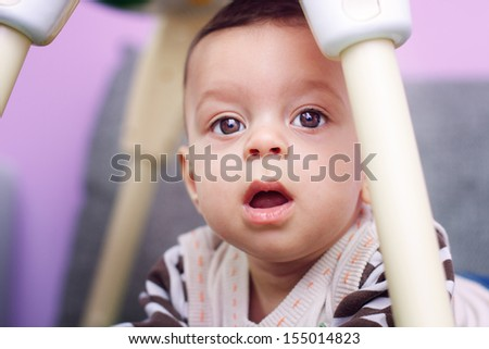 Close up portrait of cute happy little baby boy with curious view - stock photo