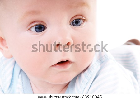 Close -up portrait of cute little baby boy in studio - stock photo