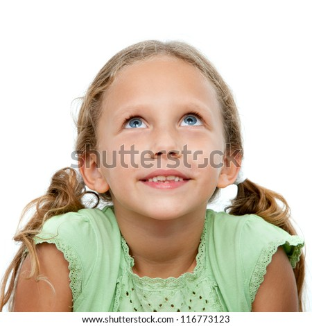 Close up portrait of cute little girl looking up.Isolated on white background. - stock photo