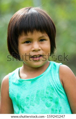 Close up portrait of cute south american girl outdoors. - stock photo