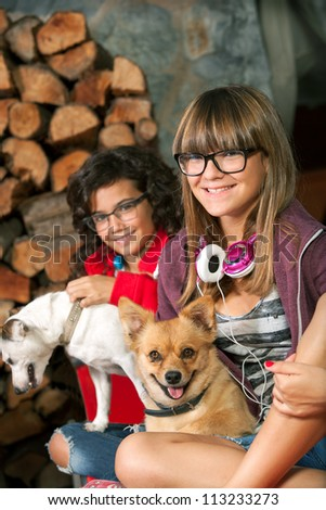 Close up portrait of cute teenage girlfriends with their dogs. - stock photo