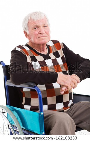 close up portrait of disabled senior man sitting on wheel chair on white background - stock photo