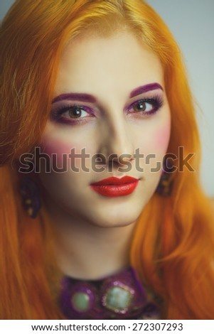 Close-up portrait of face. Young beautiful, bright, attractive, mysterious, girl, model, woman, lady, teenager, queen, princess, fairy tale. Creative make-up, bright eyes, red lips. Informal style.    - stock photo