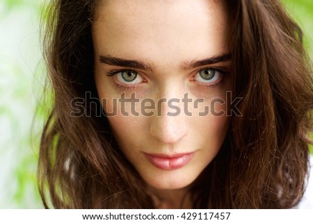 Close up portrait of female fashion model with green eyes  - stock photo