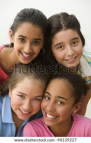 Close up portrait of four girls smiling - stock photo