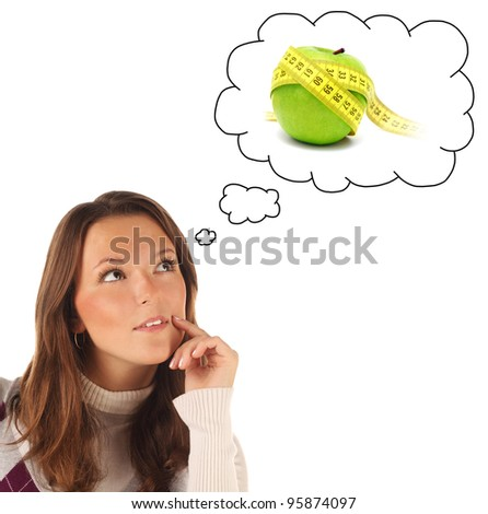 Close-up portrait of girl dreaming about healthy food isolated on white background - stock photo