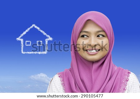 Close-up portrait of girl dreaming about house in blue sky - stock photo