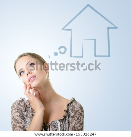 Close-up portrait of girl dreaming about house, isolated over blue background with copyspace - stock photo