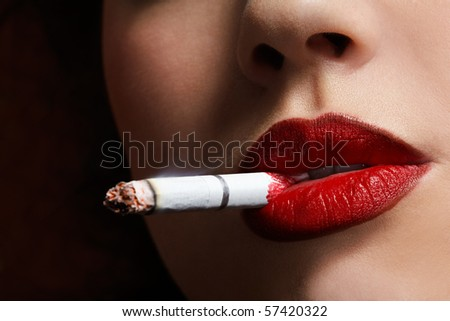 close up portrait of girl smoking cigarette - stock photo