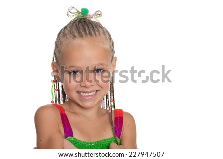 Close-up portrait of girl with dreadlocks. Girl is six years old. - stock photo