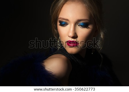 Close-up portrait of gorgeous blonde young woman in celebrity style with perfect make up and hair style. Fashion beauty photo, dramatic look - stock photo
