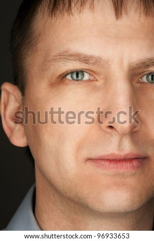 Close-up portrait of handsome caucasian man looking at camera - stock photo