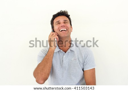 Close up portrait of handsome older man laughing with cell phone - stock photo