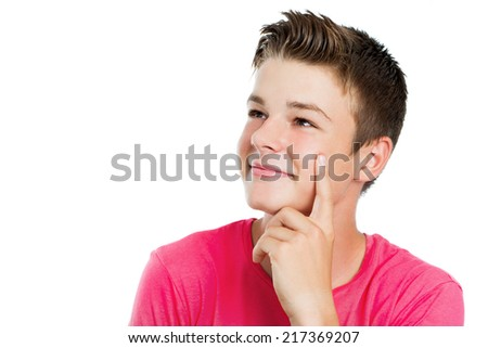 Close up portrait of Handsome teen boy wondering and looking aside.Isolated on white. - stock photo