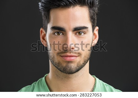 Close-up portrait of handsome young man,  isolated on white background - stock photo