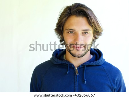 Close up portrait of handsome young man with beard on white background - stock photo