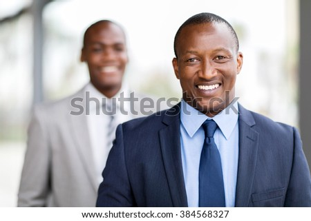 close up portrait of happy african businessman - stock photo