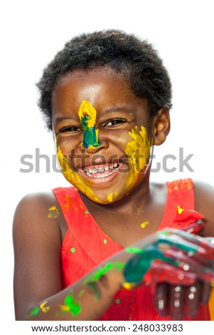 Close up portrait of happy African youngster with painted face.Isolated against white background. - stock photo