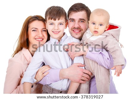 Close-up portrait of  Happy and smiles Family with children and infant on a white background isolated - stock photo