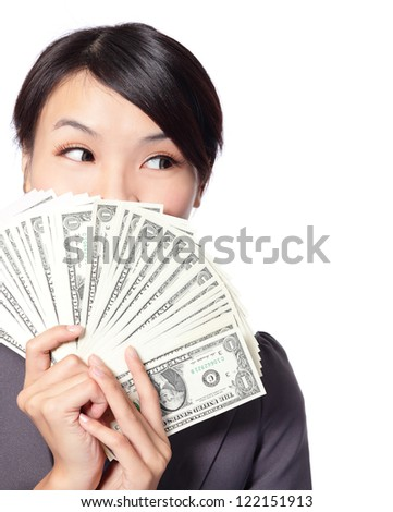 close up portrait of happy business Woman Holding Money and look to empty copy space isolated on white background, model is a asian beauty - stock photo