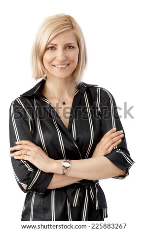 Close up portrait of happy, caucasian, blonde, elegant businesswoman, standing arms crossed, looking at camera, smiling, white background. - stock photo