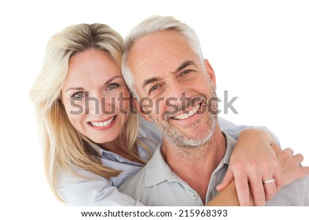 Close up portrait of happy mature couple over white background - stock photo