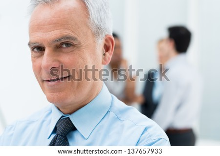Close-up Portrait Of Happy Senior Businessman in His Office - stock photo