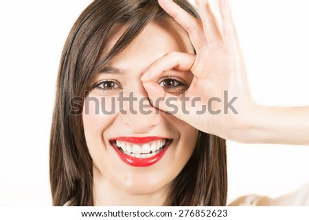 Close up portrait of happy smiling beautiful young woman showing okay gesture, studio shot on white background.  Expressive beautiful woman - stock photo
