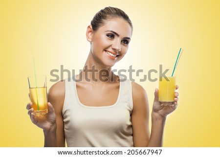 Close-up portrait of happy young woman with apple juice on white background. Concept vegetarian dieting - healthy food - stock photo