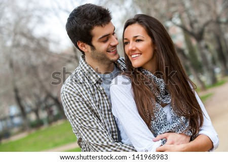 Close up portrait of in love couple outdoors. - stock photo