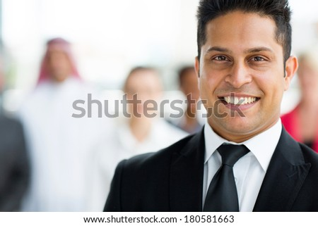 close up portrait of indian businessman - stock photo