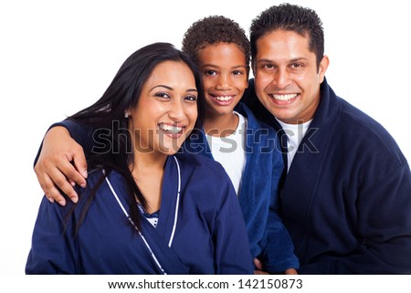 close up portrait of indian family in pajamas on white background - stock photo