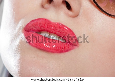 Close-up portrait of juicy, sensual, seductive and shiny lips - stock photo