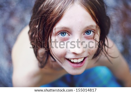 Close up portrait of little blue eyed boy - stock photo