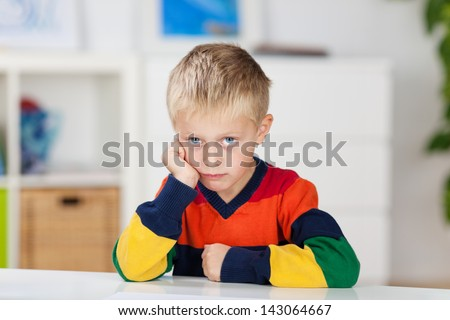 Close up portrait of little boy in a bad mood - stock photo