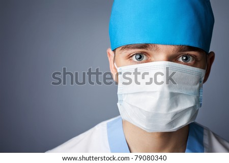 close up portrait of medical doctor in mask with copy space - stock photo