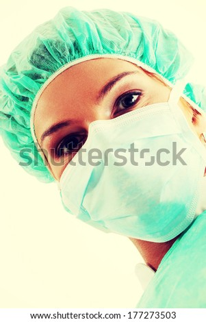 Close-up portrait of nurse or doctor in surgical mask - stock photo