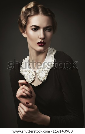 close-up portrait of old-fashioned woman - stock photo