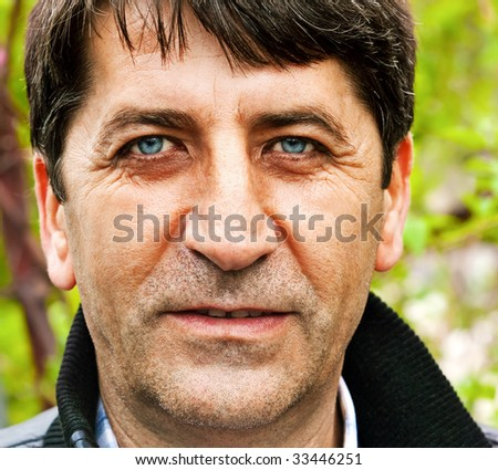 Close up portrait of one handsome happy mature man - stock photo