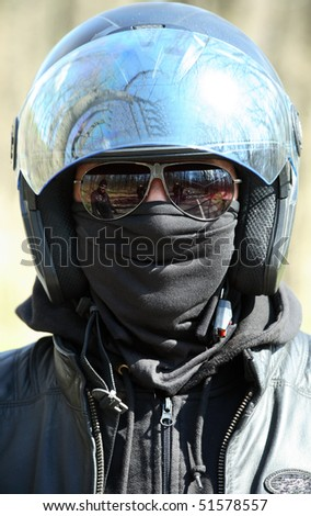 Close up portrait of racer in helmet on sunglasses - stock photo