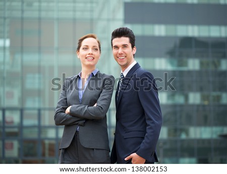 Close up portrait of relaxed business partners standing outdoors - stock photo