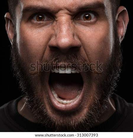 Close-up portrait of screaming and angry man - stock photo