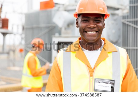 close up portrait of senior african american technician in substation - stock photo