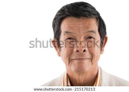 Close-up portrait of senior Asian man - stock photo