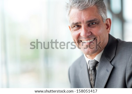 close up portrait of senior businessman in office - stock photo