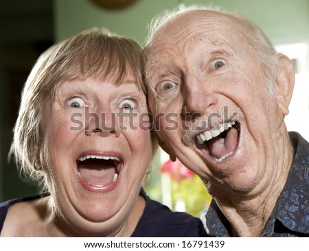 Close Up Portrait of Senior Couple - stock photo