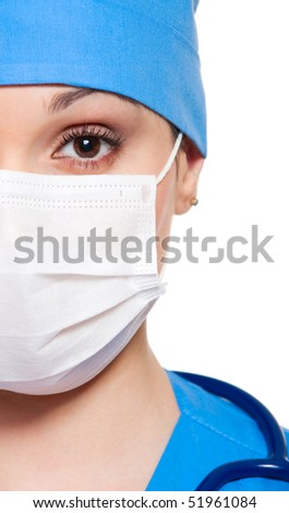 close-up portrait of serious nurse in white mask - stock photo